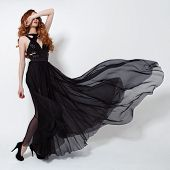 image of flutter  - Fashion woman in fluttering black dress - JPG