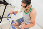 picture of exercise bike  - Man doing fitness test on exercise bike at the medical centre - JPG