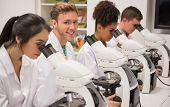 picture of microscopes  - Medical students working with microscope at the university - JPG