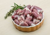 image of giblets  - Raw chicken hearts with thyme and rosemary  - JPG