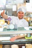 foto of confectioners  - Confectioner selling ice cream in the pastry shop - JPG