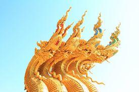 image of apex  - gold gable apex of public thai temple - JPG