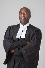 foto of toga  - Bald black man in his forties wearing a judicial toga - JPG