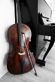 picture of cello  - Cello near piano - JPG