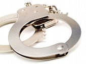 picture of handcuffs  - Close up of handcuffs isolated on white background - JPG