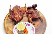 foto of quail  - Vietnamese grilled quail on a white background - JPG