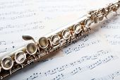 foto of flute  - Flute on music notes background - JPG