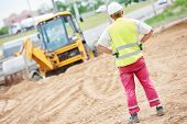 stock photo of millwright  - adult construction site manager worker at earthmoving roadwork  - JPG