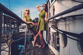 picture of old boat  - Stylish women on old rusty boat  - JPG