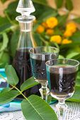 foto of home remedy  - Green  homemade  walnuts  liqueur taken as remedy for stomach aches - JPG