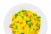 picture of boil  - Fragment of white dish with boiled rice cooked with turmeric with boiled vegetables  - JPG