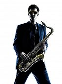 stock photo of saxophones  - one caucasian man  saxophonist playing saxophone player in studio silhouette isolated on white background - JPG