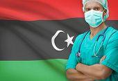 foto of libya  - Surgeon with flag on background  - JPG
