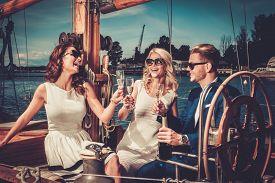 stock photo of yacht  - Stylish wealthy friends having fun on a luxury yacht  - JPG