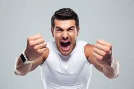 pic of shout  - Excited fitness man shouting at camera over gray background - JPG