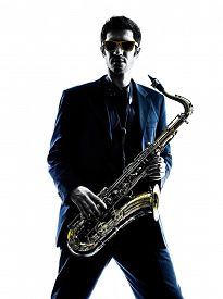 pic of saxophone player  - one caucasian man  saxophonist playing saxophone player in studio silhouette isolated on white background - JPG