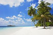 Beautiful tropical beach with powder white sand at sunlight