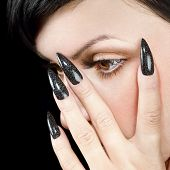 Details of young beautiful woman. Nail design and eye with long eyelashes.