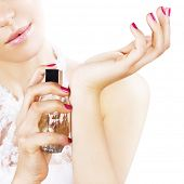 stock photo of perfume  - Woman spraying perfume on her wrist - JPG