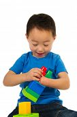 picture of physically handicapped  - Light handicapped Chinese boy is playing with toys - JPG