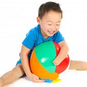 stock photo of physically handicapped  - Little Chinese boys with light handicap hand playing with beach ball - JPG