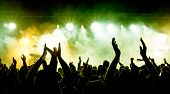 foto of crowd  - silhouettes of concert crowd in front of bright stage lights - JPG