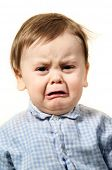 stock photo of sad face  - portrait studio baby - JPG