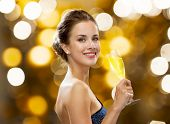 party, drinks, holidays, luxury and celebration concept - smiling woman in evening dress with glass  poster
