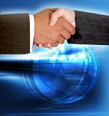 Abstract background with a globe and man and woman shaking hands