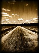 Grungy old photo of a dirt road
