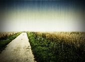 Aged photo of a dirt road, cross-processed and vignetted