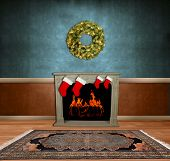Room with fireplace, stockings & holiday wreath