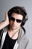 Dj listening to music on his headphones