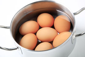 foto of boiling water  - Brown eggs in water in a metal pot - JPG