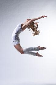foto of ballet dancer  - modern ballet dancer posing on white background - JPG