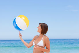 picture of beach-ball  - Lovely woman with her ball on the beach - JPG