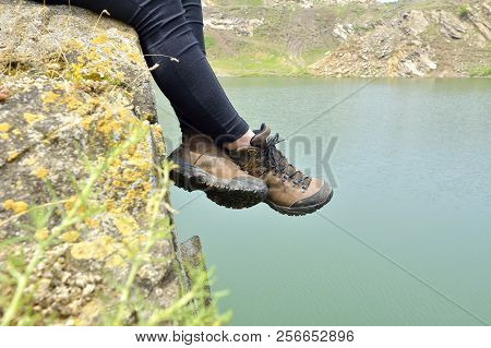 poster of Walking Shoes. All Terrain Shoes. Hiking Shoes On Hiker Outdoors Walking Crossing River Creek. Woman