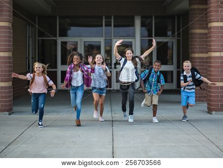 Group of school kids running