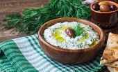 Tzatziki Sauce In Bowl On Rustic Wooden Background. Greek Cuisine. Healthy Vegetarian Food. Selectiv poster