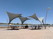 Awnings Shielding Recreation Area From Merciless Hot Sun At Salt River Lakeside In Tempe, Arizona; C poster