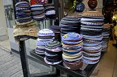 stock photo of tora  - pile of kippas on display in store front - JPG