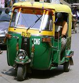 auto rickshaw driving on road, delhi, india