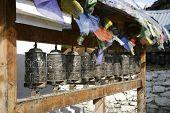 praying wheels and flags in manang, annapurna, nepal