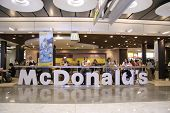 MADRID, SPAIN - AUGUST 7 : Customers having their meals at McDonald's Madrid airport in Madrid, Spain on August 7, 2007. Madridâ??s metropolitan area is the fourth most populous area in Europe.