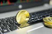 Golden Titan Bitcoin Coin With Gold Coins Lying Around On A Silver Keyboard Of Laptop And Diagram Ch poster