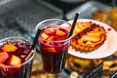 Refreshing Sangria Or Compote With Fruits Stands Near Cakes poster