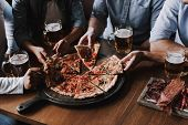 Close Up Of People Hands Taking Slices Of Pizza. Smiling Friends Eating Pizza And Drinking Beer At R poster