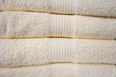 Clean Towels. Many Clean White Towels Are Neatly Stacked On The Shelf. poster