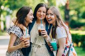 Summer Lifestyle Portrait Multiracial Women Enjoy Nice Day, Holding Glasses Of Milkshakes. Happy Fri poster