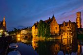 Famous view of Bruges tourist landmark attraction - Rozenhoedkaai canal with Belfry and old houses a poster